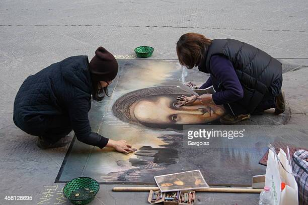 mona lisa unfinished - street artist stock photos and pictures