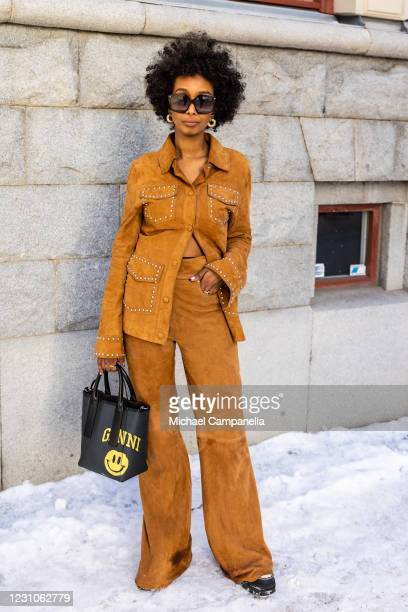 Mona M Ali wearing an outfit from Stand Studio poses for a picture outside of Hotel Diplomat on the first day of Stockholm Fashion Week Autumn/Winter...