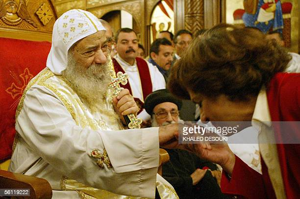 Mona Makram Ebeid a Coptic candidate in Egypt's parliamentary elections kisses the hand of Pope Shenouda III at the church of Virgin Mary in the...