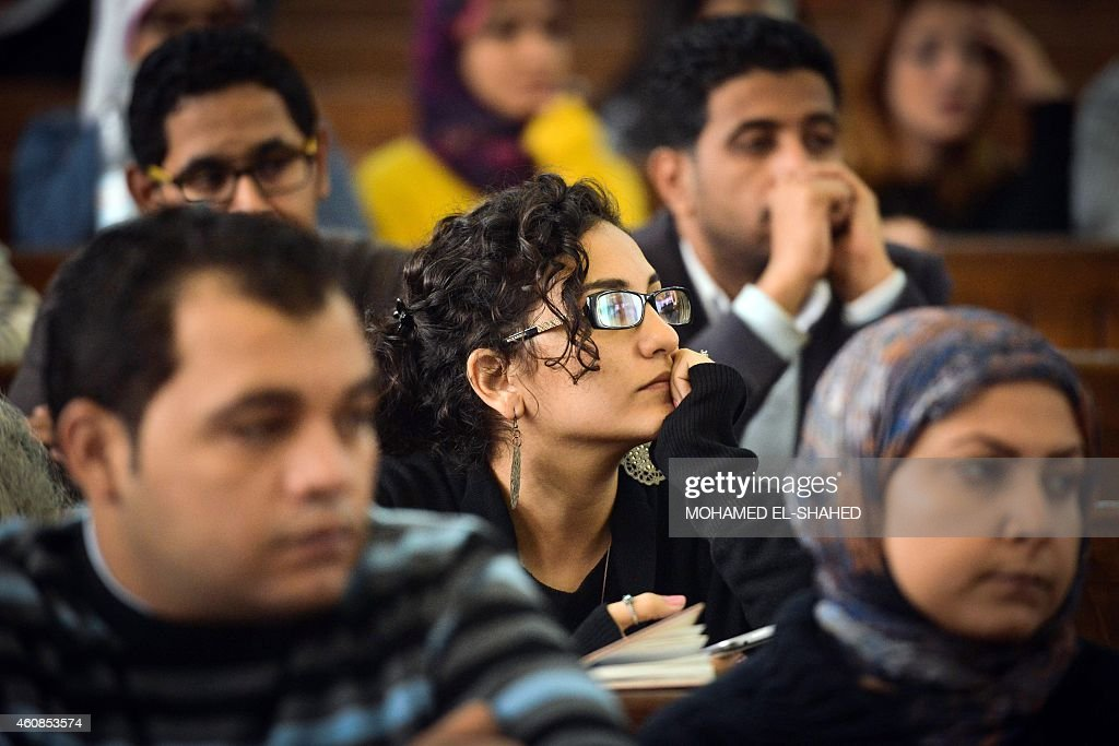 Mona Soueif (C), the sister of Alaa Abdel Fattah, attends the retrial of her son and 24 others, in the courtroom in Cairo on December 27, 2014. The defendants were sentenced in June to 15 years in prison for holding an unlicensed and violent protest outside the Shura council last November in objection to the military trials of civilians.