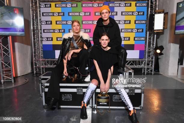 Mona Walravens Juliette Dol and Agathe Mougin arrive at MOSCHINO [tv] HM Launch Party at Le Dernier Etage on November 6 2018 in Paris France