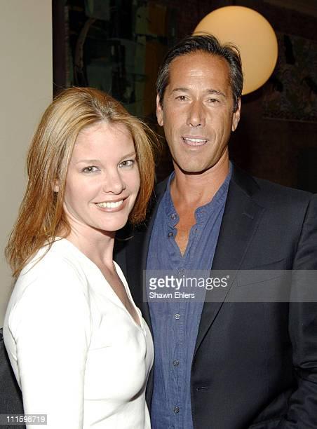 Mona Wyatt and Randy Schlinder during Olympus Fashion Week Spring 2006 Sanjana Jon Front Row and Backstage at Harbor Saft in New York City New York...