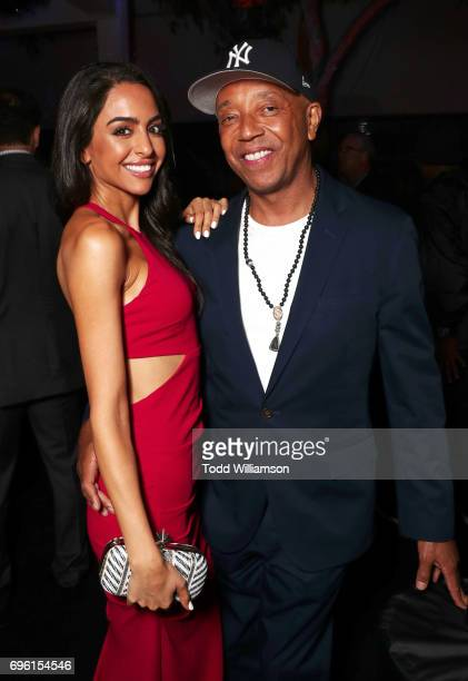 Mona Zohrehvand and Russell Simmons at the ALL EYEZ ON ME Premiere at Westwood Village Theatre on June 14 2017 in Westwood California