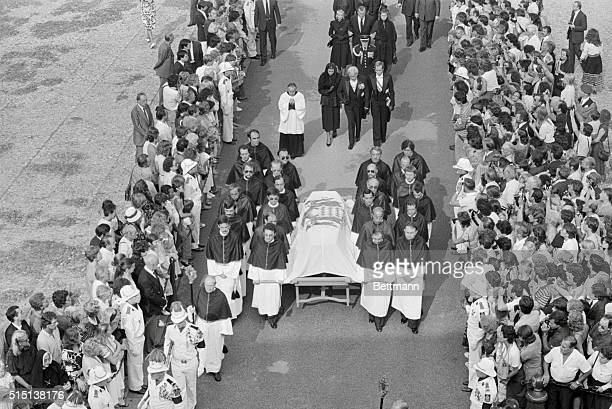 A weeping Prince Rainier flanked by daughter Princess Caroline and son Prince Albert walks behind the coffin bearing his wife Princess Grace to the...