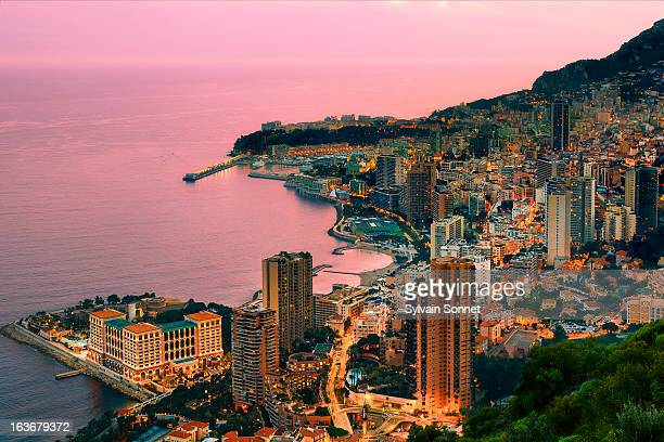 monaco, aerial view at dusk - monte carlo stock-fotos und bilder