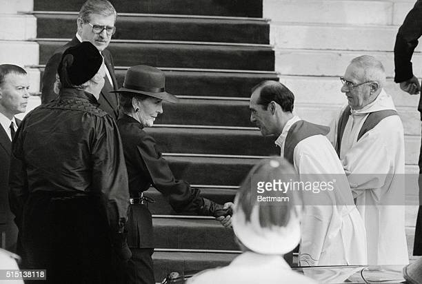 American First Lady Nancy Reagan is greeted by abbot Fabrice outside Monaco's Cathedral prior to the 9/18 funeral mass for Princess Grace of Monaco...