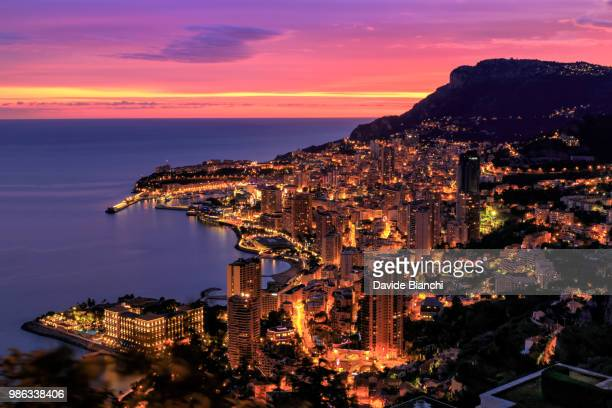 monaco by night - monte carlo stock-fotos und bilder