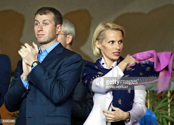 Chelsea's Russian President Roman Abramovitch and his wife attend the Champions League semi-final first-leg football match between Monaco and...