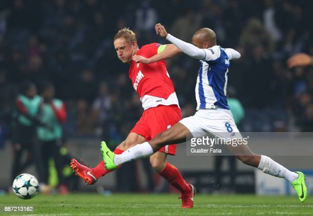 Monaco defender Kamil Glik from Poland with FC Porto forward Yacine Brahimi from Algeria in action during the UEFA Champions League match between FC...