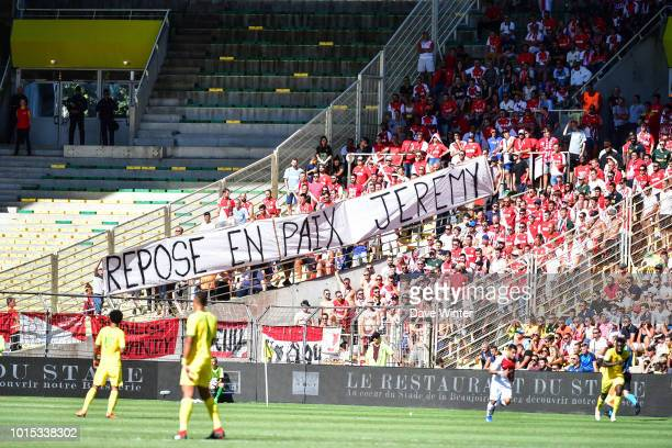Monaco fans hold up a banner during the French Ligue 1 match between Nantes and Monaco at Stade de la Beaujoire on August 11 2018 in Nantes France
