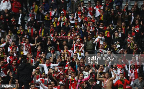 Monaco fans soak up the atmosphere inside the ground prior to the UEFA Champions League Quarter Final first leg match between Borussia Dortmund and...