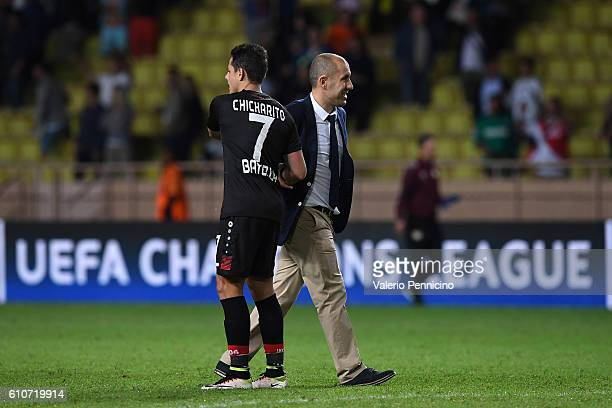 Monaco FC head coach Leonardo Jardim consoles Javier Hernandez of Bayer 04 Leverkusen at the end of the UEFA Champions League Group E match between...