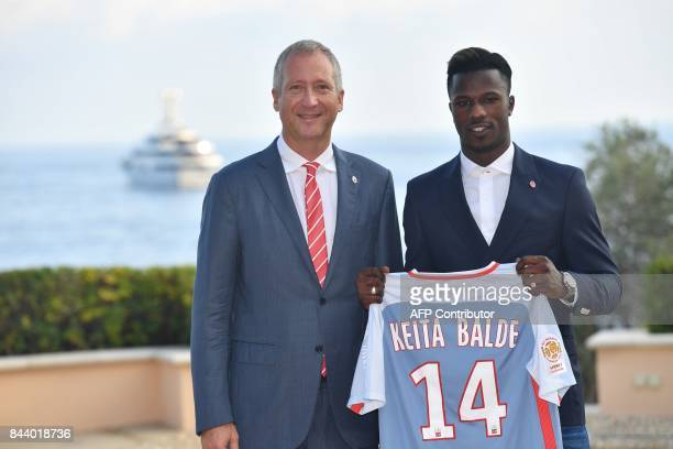 AS Monaco football club's newly recruited Spanish forward Keita Balde poses with his new jersey next to Monaco's Russian VicePresident Vadim Vasilyev...