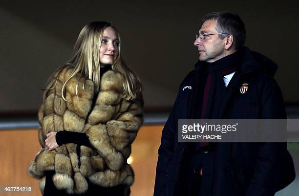 Monaco football club's Russian president Dmitriy Rybolovlev with an unidentified woman attend the French League Cup quarterfinal football match...