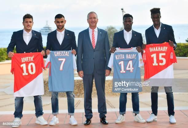 AS Monaco football club's Russian VicePresident Vadim Vasilyev poses with newly recruited Yugoslavian forward Stevan Jovetic French midfielder Rachid...