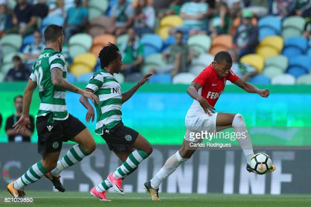 Monaco forward Kylian Mbappe from France tries to escape Sporting CP forward Gelson Martins from Portugal during the Friendly match between Sporting...