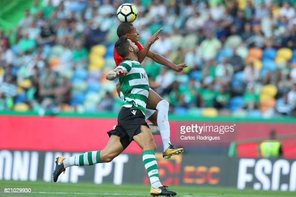 Monaco forward Kylian Mbappe from France vies with Sporting CP defender Cristiano Piccini from Italy during the Friendly match between Sporting CP...