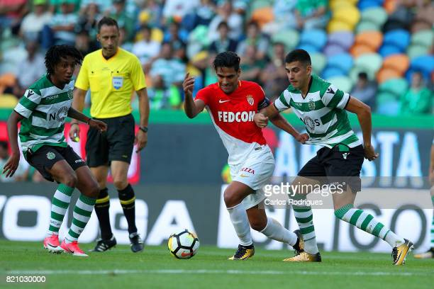 Monaco forward Radamel Falcao from Colombia vies with Sporting CP midfielder Rodrigo Battaglia from Argentina during the Friendly match between...