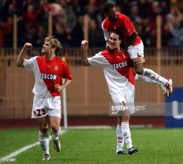 Monaco forwards Jerome Rothen Dado Prso and defender Patrice Evra jubilate after scoring a goal, 05 November 2003, at the Louis II stadium in Monaco...
