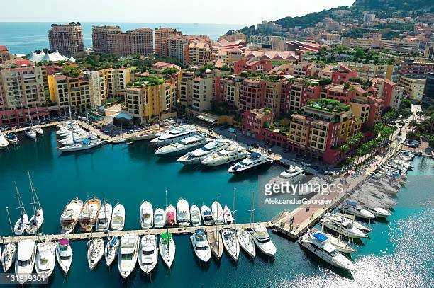 monaco harbor with yachts and speed boats - monaco stock pictures, royalty-free photos & images
