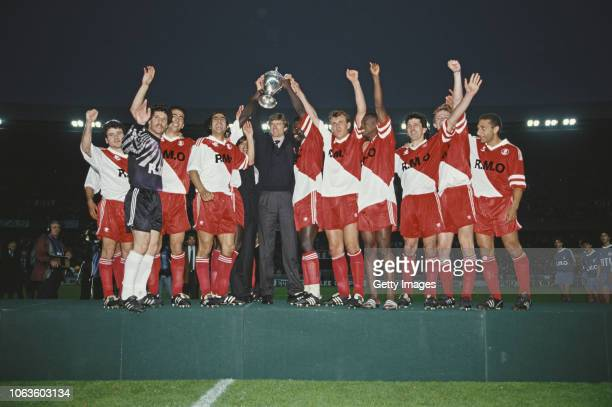 Monaco manager Arsene Wenger lifts the trophy with striker George Weah after Monaco had beaten Marseille in the 1991 Coupe de France Cup Final at...