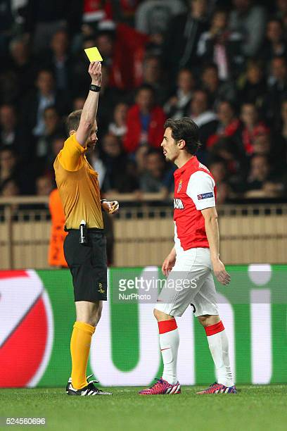 Monaco midfielder Bernardo Silva is shown a yellow card by the referee William Collum during the Uefa Champions League quarter final football match...