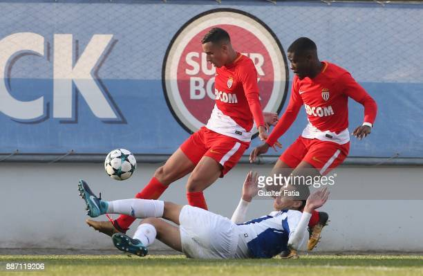Monaco midfielder Mehdi Zerkane from France and Monaco defender Yannis Yapende from France with FC Porto defender Diogo Leite in action during the...