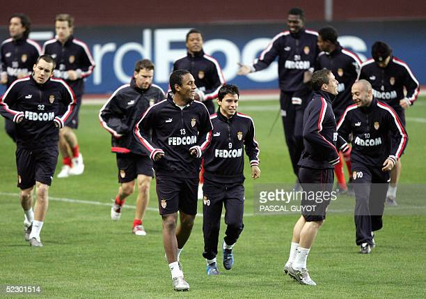 AS Monaco players Gael Givet Douglas Maicon Javier Saviola and Ernesto Javier Chevanton practice during a training session on the eve of the...
