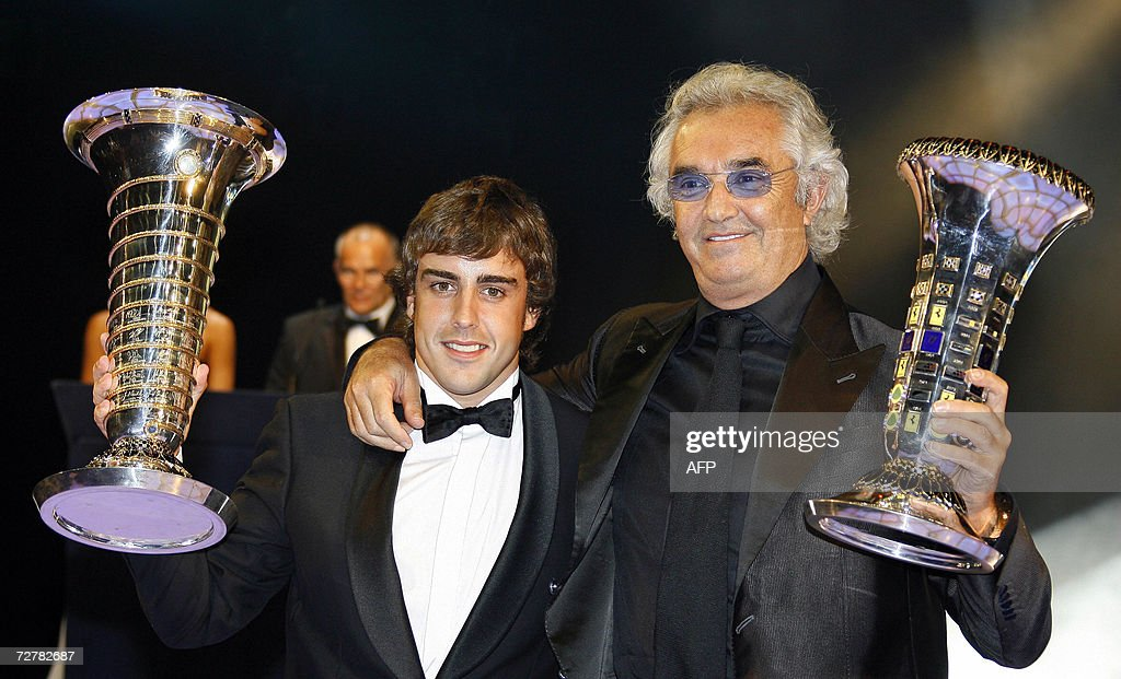 Formula one world champion Fernando Alonso (L) of Spain and Renault team manager Flavio Briatore (R) pose with their trophies during the 2006 FIA Awards gala 08 December 2006 in Monaco.