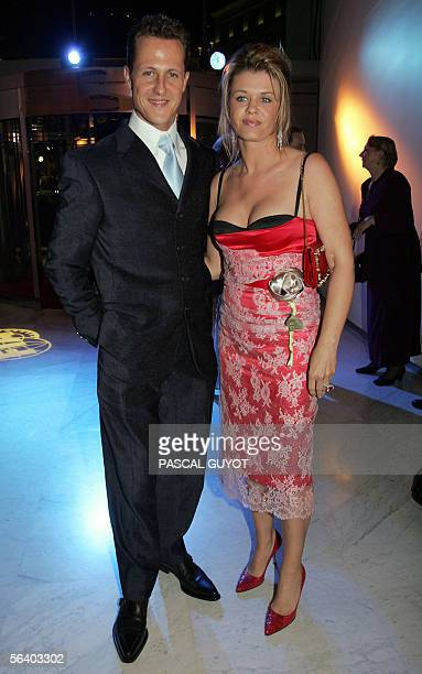 German formula one driver Michael Schumacher and his wife Corinna pose prior the 2005 FIA Awards gala 09 December 2005 in Monaco Alonso won the FIA...