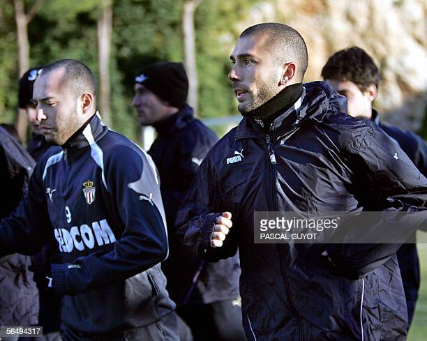 Italian Marco Di Vaio new Monaco's player and former Spanish football club of Valencia's striker is seen with new teammate Urugayan forward Javier...