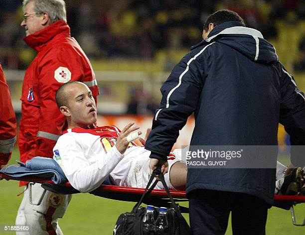 Monaco's Ernesto Javier Chevanton is taken off the field on a stretcher during the French League Cup football match MonacoGuingamp 21 December 2004...