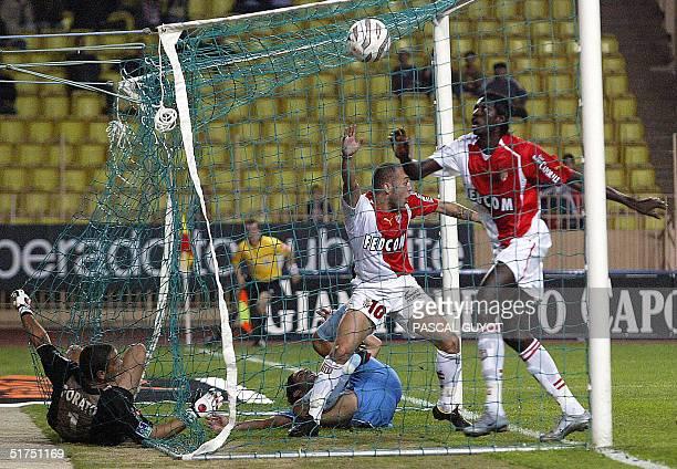 Monaco's Urugayan forward Javier Chevanton celebrates after scoring a goal next to his teammate Togolese forward Emmanuel Adebayor and Ajaccio's...