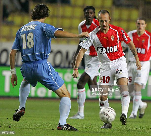 Monaco's Urugayan forward Javier Chevanton vies with Ajaccio's defender Nenad Dzodic during their French L1 football match 06 November 2004 at the...