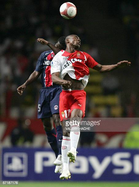 Paris SaintGermain's French defender Bernard Mendy vies with Monaco's French midfielder Olivier Kapo during their French L1 football match 26 March...