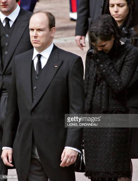 Prince Albert of Monaco and his niece Charlotte Casiraghi wollow the coffin of late Prince Rainier III before attending the funeral mass at the...