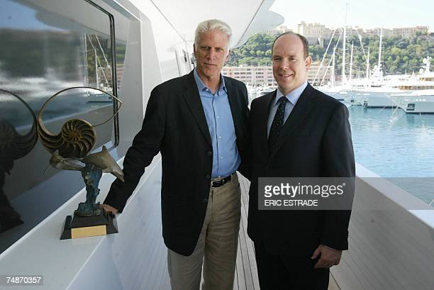Prince Albert of Monaco and US actor and activist Ted Danson pose on a yacht after Danson was awarded with the lifetime service SeaKeeper Award at...