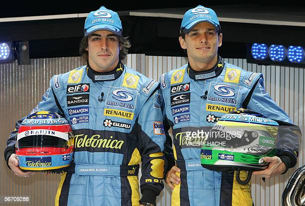 Renault drivers Italy's Giancarlo Fisichella and Spain's Fernando Alonso pose during the presentation of the new Renault R26 Formula One for the 2006...