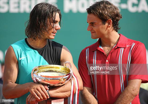 Spanish Rafael Nadal poses next to Swiss Roger Federer at the end of their Monte Carlo ATP Masters Series tournament tennis final match 22 April 2007...