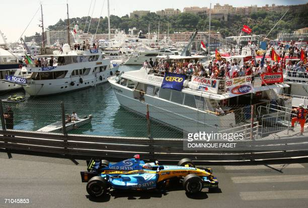 Spanish Renault driver Fernando Alonso steers his car during the first practice session at the Monaco racetrack, 25 May 2006 in Monaco, three days...