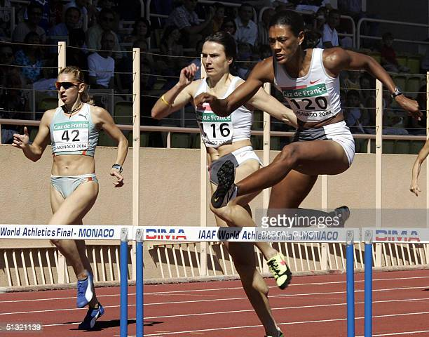US Sandra Glover competes with Greek Fani Halkia and Ukrainian Tetyana during the 400m hurdles race of the IAAF World Athletics Finals 18 September...