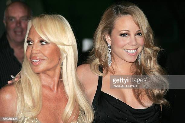 US singer Mariah Carey and Italian designer Donatella Versace arrive to attend the Swarovski Fashion rocks for The Prince's Trust at the Grimaldi...