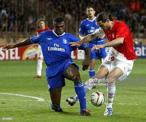 Monaco's Croatian forward Dado Prso and Chelsea's French defender and captain Marcel Desailly try to intercept the ball during their Champions League...