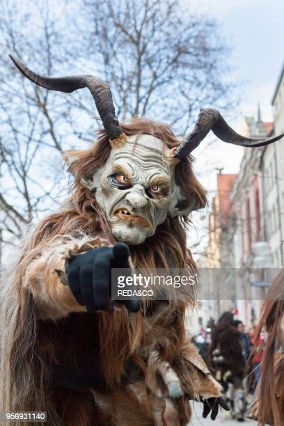 Monaco of Krampuslauf or Perchtenlauf during Advent in Monaco of Bavaria an old tradition that takes place during the Christmas season in the Alps of...