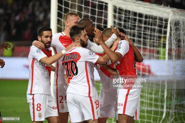 Monaco players celebrate after scoring a goal during the French L1 football match between Monaco and Lille at the Louis II Stadium in Monaco on May...