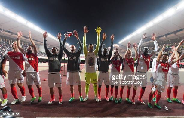 Monaco players celebrate their victory at the end of the French L1 football match between Monaco and Lille at the Louis II Stadium in Monaco on May...