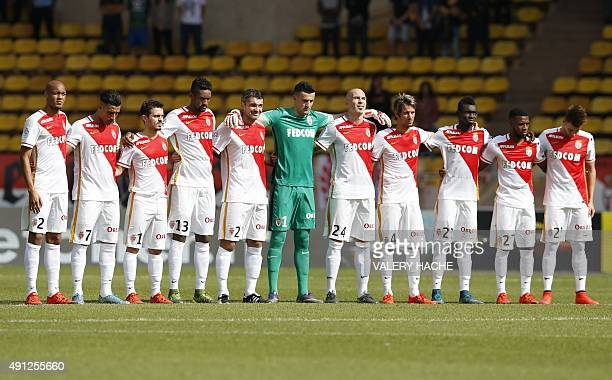 Monaco players observe a minute of silence in hommage of victims of floods on October 4 2015 before the French L1 football match Monaco vs Rennes at...
