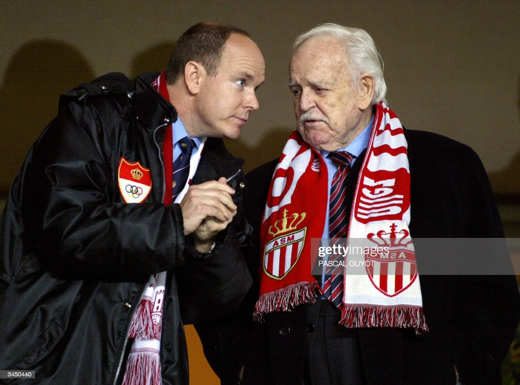Prince Albert of Monaco (L) and his father Prince Rainier chat as they watch the Champions League semi-final first-leg football match between Monaco and Chelsea, 20 April 2004 at the Louis II stadium in Monaco. Monaco won 3-1.