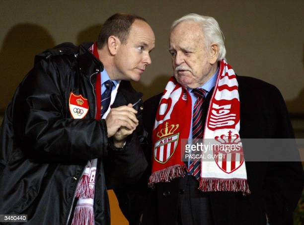 Prince Albert of Monaco and his father Prince Rainier chat as they watch the Champions League semi-final first-leg football match between Monaco and...