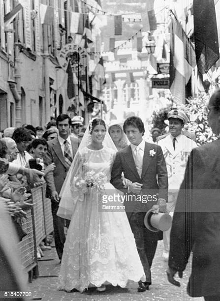 Princess Caroline and Philippe Junot walk through the flagbedecked streets of old Monaco after their June 29 civil wedding service